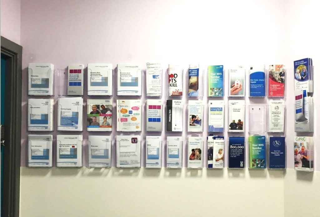 Over 30 different leaflets advice leaflets mounted on a wall