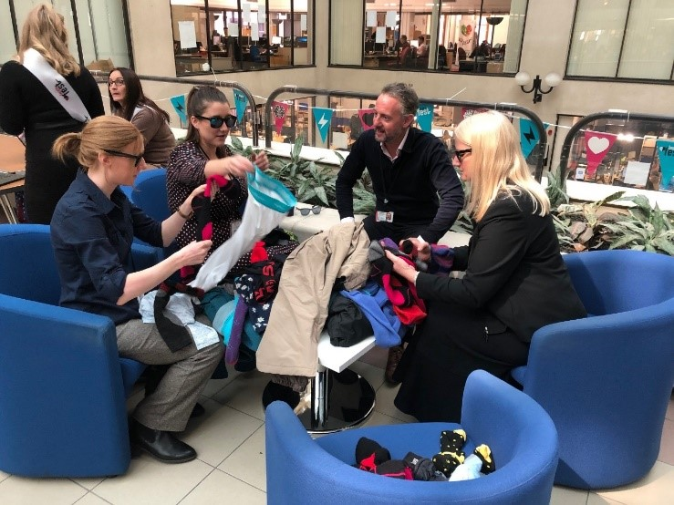 a group matching socks with glasses mimicking the effects of macular degeneration at learn fest