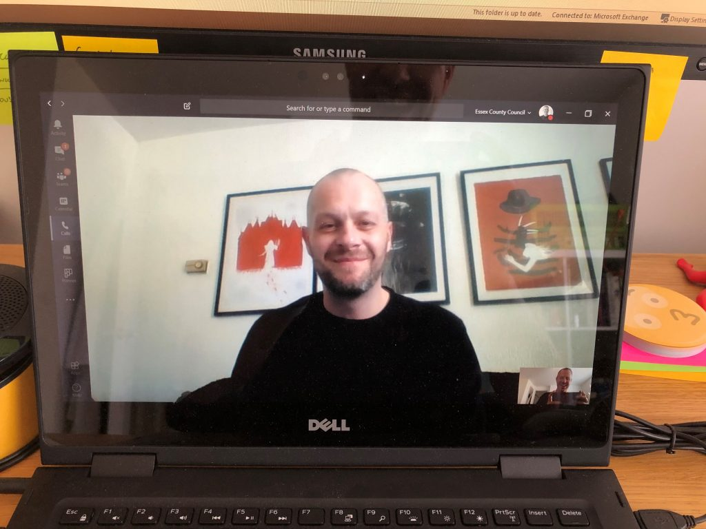 image of author on a video call on a laptop