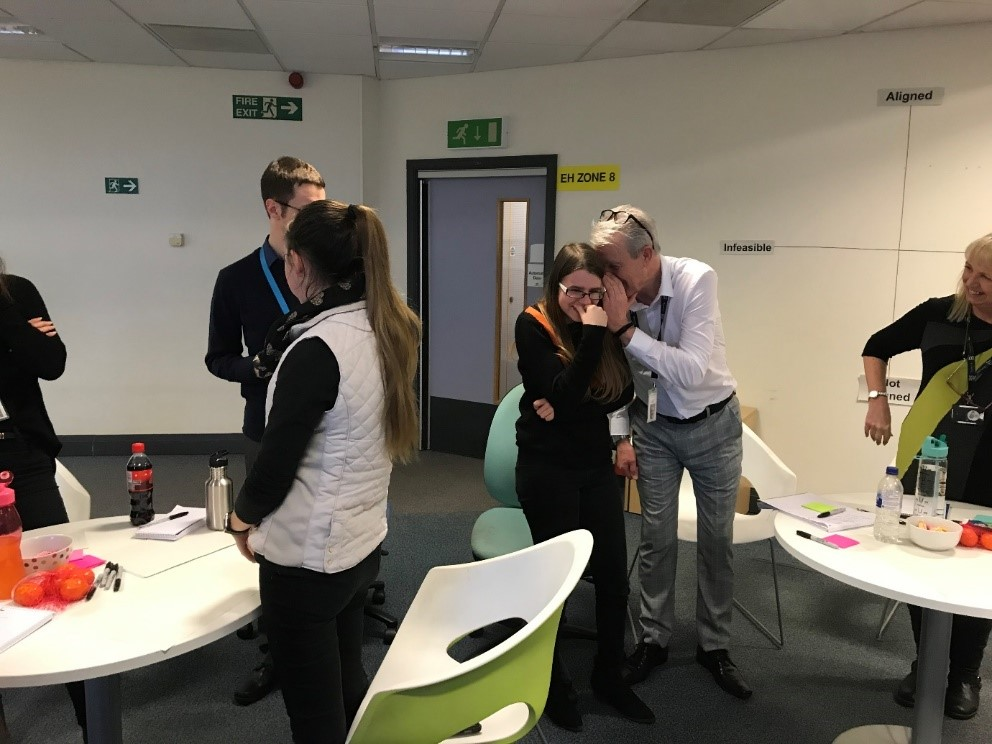Workshop participants playing Chinese whispers